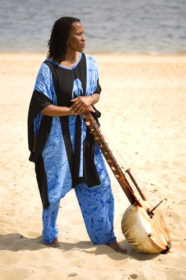 Charlotte Blake Alston kora storyteller beach portrait griot African musical instrument