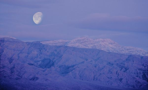 Death valley national park california sunrise moonset purple mountains mojave desert lowest elevation below sea level